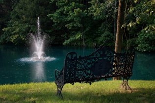 Antique iron bench provided by Garden Style Living to The Farm as seen in New York Times