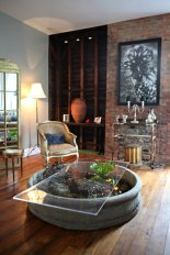 "End table, French bergere, gold pedestal and ""bar cart"" provided by Garden Style Living to The Farm as seen in New York Times"