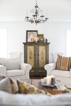 Vintage crystal chandelier, coffee table tray and brass candle sticks provided by Garden Style Living and design by LeanneFordInteriors.com as seen on ABC television