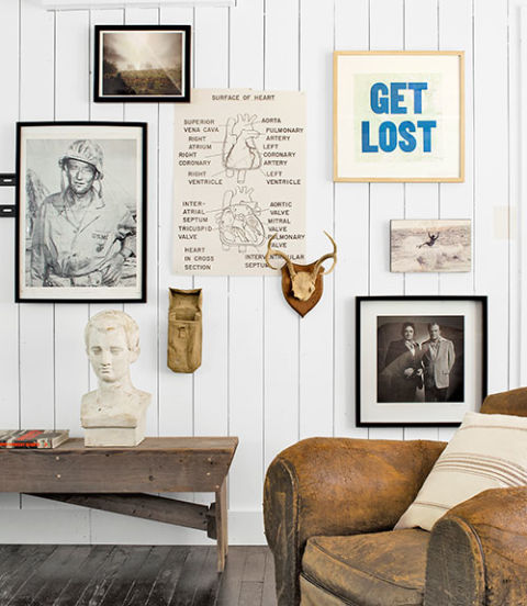 Antique bench, military bag and horns provided by Garden Style Living and design by LeanneFordInteriors.com as seen in Country Living magazine