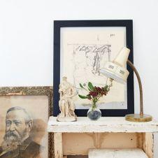 Domino Magazine / Benches and statue : Garden Style Living / Design : Leanne Ford Interiors / Photo : Nichole Franzen