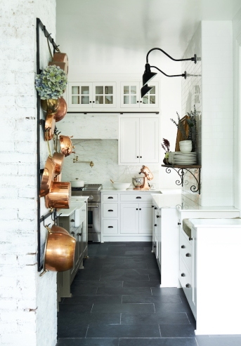 Complete antique copper collection, antique iron brackets, antique ironstone bowl and accessories in glass cabinets from: Garden Style Living / Pictured from: HGTV's Restored by the Fords / Design: Leanne Ford Interiors / Photo: Alexandra Ribar