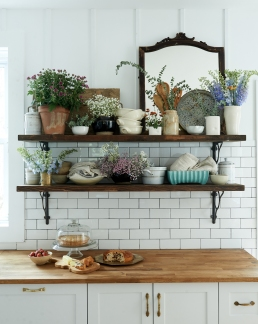 Vintage cello cutting board, vintage mirror from: Garden Style Living / Pictured from: HGTV's Restored by the Fords / Design: Leanne Ford Interiors / Photo: Alexandra Ribar