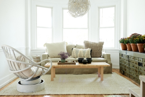 Vintage rattan chair and pottery from: Garden Style Living / Pictured from: HGTV's Restored by the Fords / Design: Leanne Ford Interiors / Photo: Alexandra Ribar