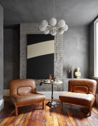 Mid Century Peace Sign and Vintage chalk ware bust: provided by Garden Style Living to Leanne Ford: and used here on HGTV Restored by the Fords / Photo: Reid Rolls