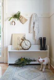 Large clock and horseshoe provided by Garden Style Living / design by LeanneFordInteriors.com as seen on HGTV and CountryLiving.com / photo by Reid Rolls